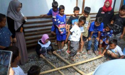 Animo anak-anak merasakan pertama kali permainan Rangku Alu. (ist)